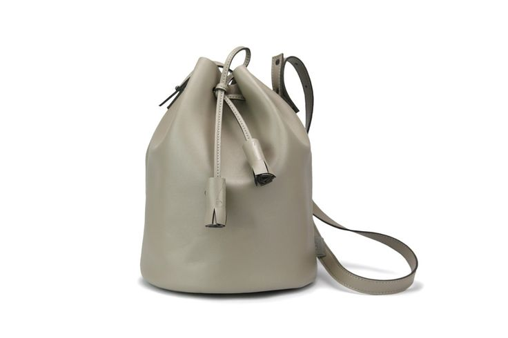 The Corin bucket bag is a modernized classic style that is minimal and clean. Designed with M.R.K.T.'s signature premium MCRO LEATHER and MCRO SUEDE for supple and smooth exterior texture without forgoing durability.