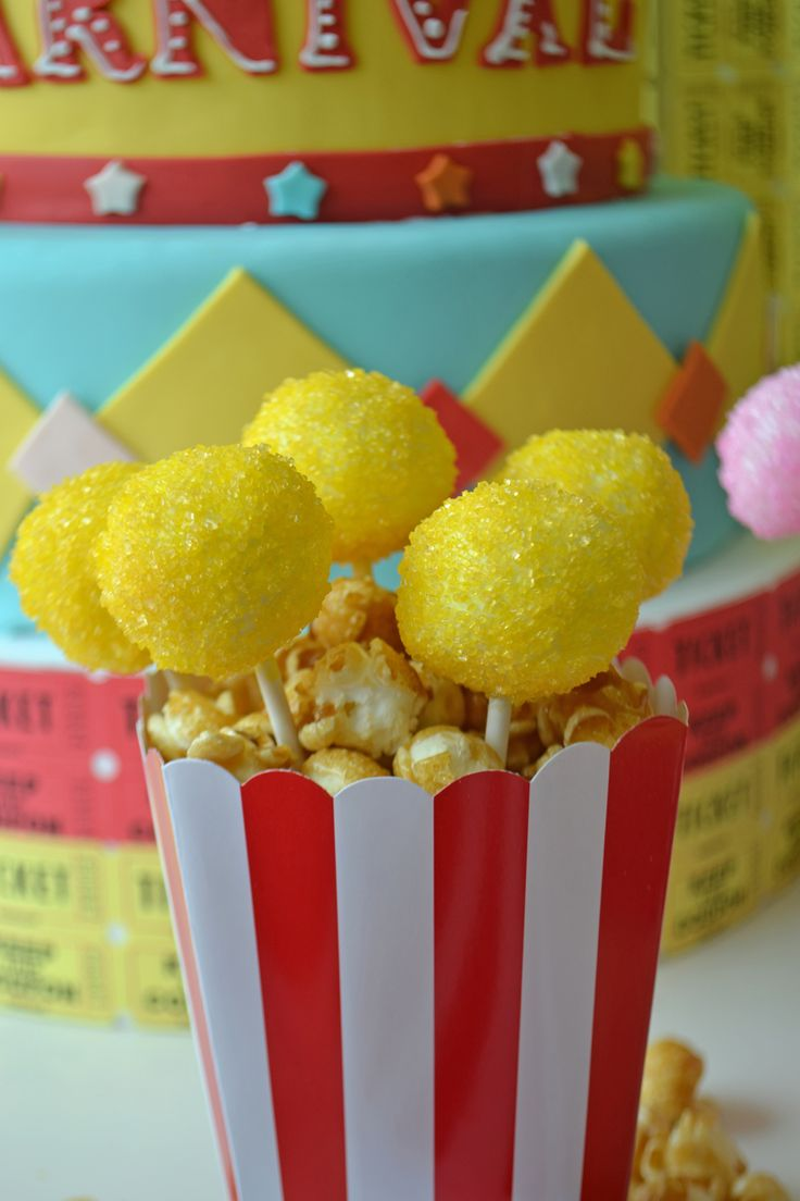 Sparkling cake pops in a festive red and white popcorn bag. Treats by Bake Sale.