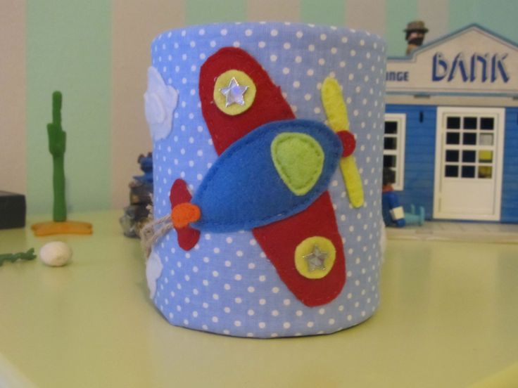 Pencil holder. Can, fabric and felt. Made this for my son and he loves it!