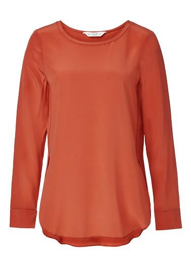 100% Ls Silk top. Comfortable fitting silhouette features long sleeves, scoop neckline and slightly dipped hem. Available in various colours.