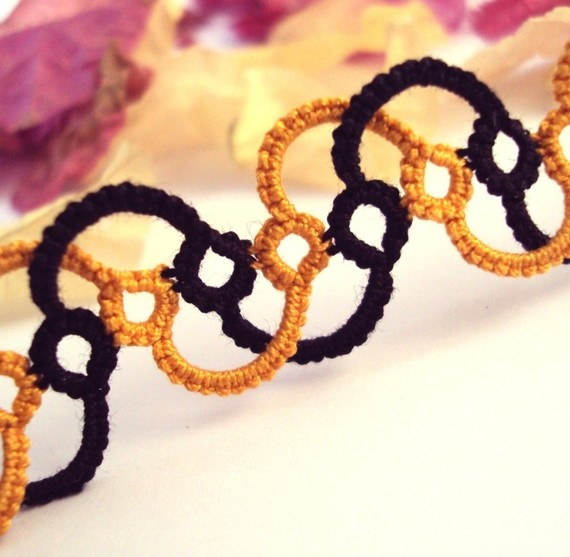 Cool two-color tatted bracelet.