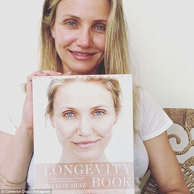 She wants you to grow old: Fresh-faced Cameron Diaz shared a make-up free selfie on Wednesday to promote her new lifestyle guide The Longevity Book