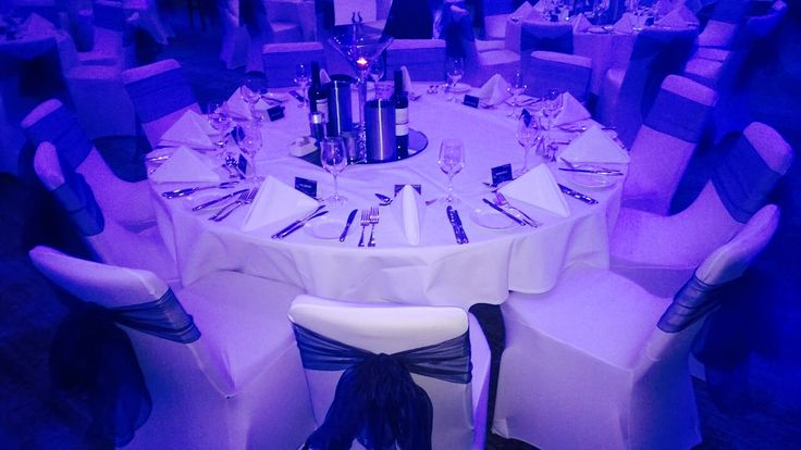 Beautiful white chair covers with dark navy sashes at Radisson Blu East Midlands Airport