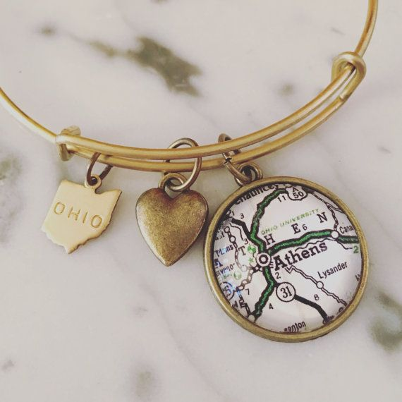 Ohio University love! This bracelet is antique brass and includes 1 Athens map charm, 1 Ohio brass charm, and 1 heart charm. Stack these with