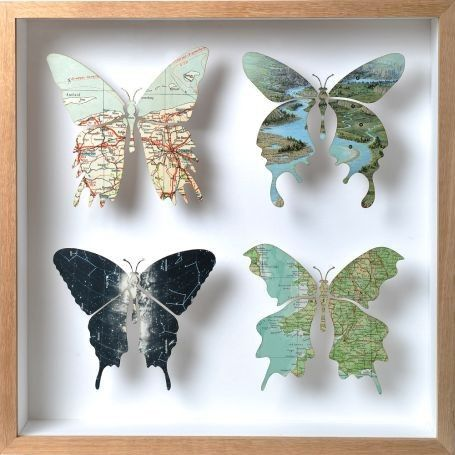 For my butterfly loving friend! Cut from maps or maybe book pages.