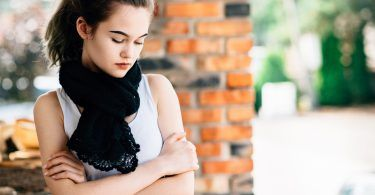 Portrait of thoughtful young teen girl on terrace