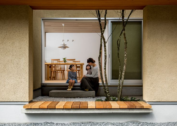 A tree grows up from the garden inside this house in Japan's Shiga prefecture, which was designed by Japanese studio Hearth Architects.