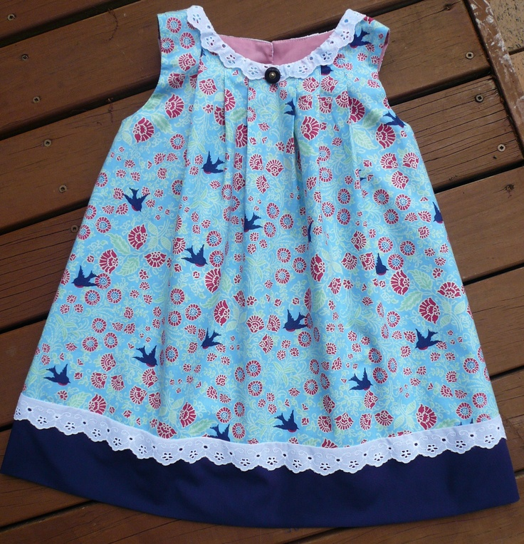"""This dress is made from one of my favourite designs I call  """"New Passions.""""  The blue bird fabric came from http://www.facebook.com/2littlebowerbirds."""