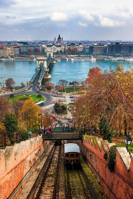 Budapest, Hungary - Climbing Castle Hill. A tram makes its way up Castle Hill in Budapest with the Chain Bridge in the background.