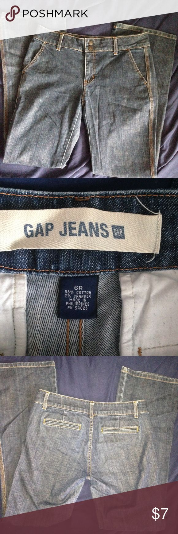 """Gap trouser Jean, 6/8R Older but goody Gap trouser jeans. Slant front pockets, slit rear pockets. Size 6R but generously cut (as I am not a size 6 Haha). I'd call them more like an 8-10. Measurements flat are: waist flat 16"""", hips 19"""", rise 9"""", inseam 32"""", leg opening 9.25"""". These are in good+ condition. There is the Faintest wear (lighter spot) to the Left knee. These are blue, not black/gray-blue like my lighting wants you to believe 🙄 truest color is close up of rear pocket GAP Jeans…"""