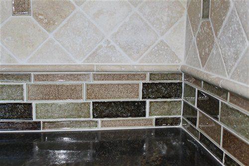 Maniscalco brick joint glass and tumbled stone backsplash for Tumbled glass tile