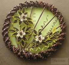 из газет - Поиск в Google - Recycled Newspaper Frame with Quilled Fowers, Leaves, Grasses, and spirals