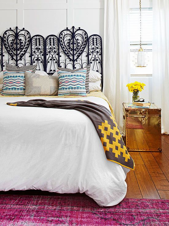 Vintage Verve - an overdyed fucshia rug, a flea market headboard, and a gold trunk-turned-nighstand introduce whimsy.