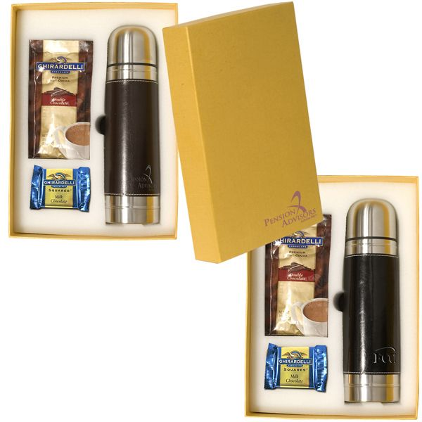 """Ghirardelli (R) Gift Set. The Empire Leather-Wrapped Thermos with five packets of Ghirardelli (R)  Premium Hot Cocoa Mix and five squares of Ghirardelli (R) Chocolate. Each cocoa packet makes 6 oz. and each chocolate square is .53 oz.  Thermos:  10"""" tall with 2 3/4"""" bottom dia; Gift Box: 11-1/2""""w x 8-1/4""""h x 3-1/4""""d.  Part of the Leeman New York Collection.  Lifetime guarantee. Supplier is QCA certified."""