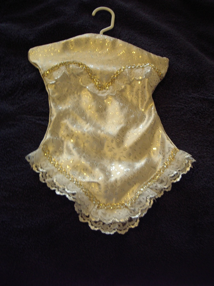 Gold satin with gold floral print, trimmed with white lace with golden trim. This is a Lingerie Keeper I made.  It opens along the bustline to a full length pocket. This could also be used as a Santa Stocking for hiding Christmas goodies.