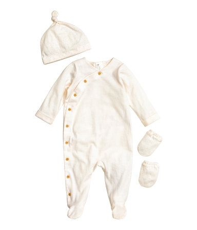 Natural white. BABY EXCLUSIVE/CONSCIOUS. Welcome to the world set in soft, organic cotton jersey. Footed jumpsuit with buttons at one side and along one leg