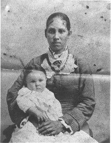 Martha Davis Wilson daughter of Mahala and Isaac P. Davis born in Virginia in 1848. She holds her daughter, Julia Davis (Carr).