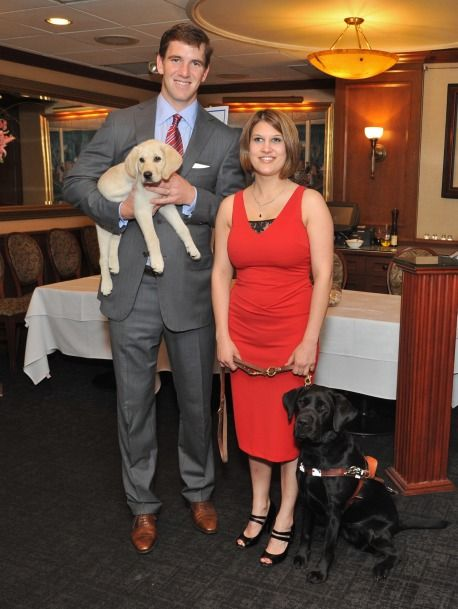 NY Giants Quarterback Eli Manning and puppy Prince with Guiding Eyes graduate Kate Katulak and her guide dog, Hosta, at the Spring Tee-Off for the 36th annual Guiding Eyes for the Blind Golf Classic. Photo by: John Vecchiolla