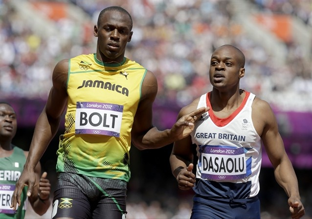 Jamaica's Usain Bolt, left, and Britain's James Dasaolu react after competing in a men's 100-meter heat during the athletics in the Olympic Stadium at the 2012 Summer Olympics, London, Saturday, Aug. 4, 2012. (AP Photo/Anja Niedringhaus)