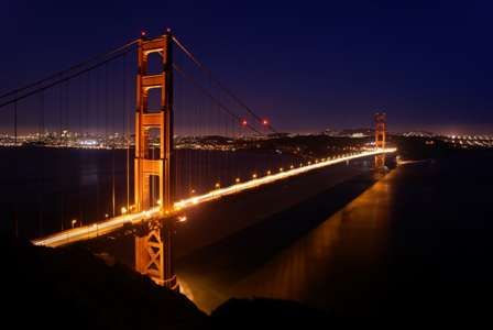 They sat for a while in silence, admiring the majestic span of the Golden Gate, blazing a trail across the bay in the sunset, the fog sitting like a carpet of mist over the water and the lights of the city laid out behind.