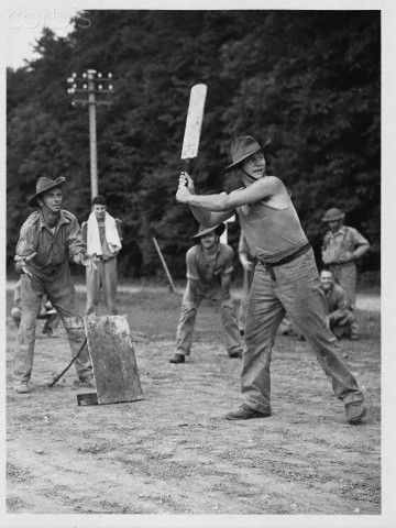 Australian Soldiers playing cricket , probably in KL during the second war.