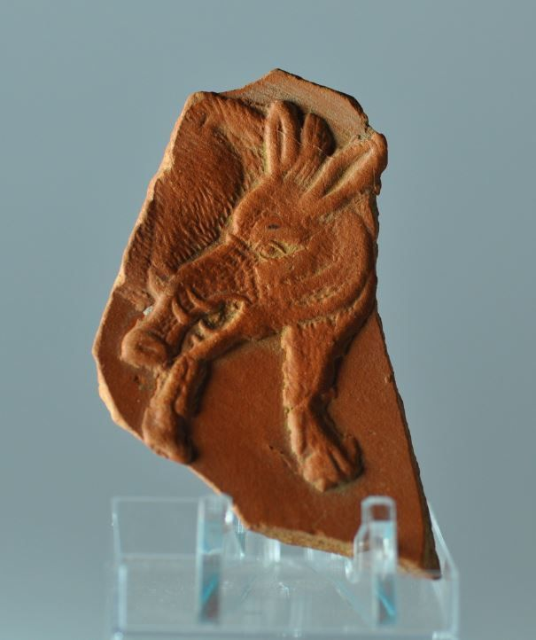 Roman terra sigillata plate fragment with boar, 4th-5th century A.D. African red slip ware plate fragment, North Africa, with boar, 8 cm high. Private collection