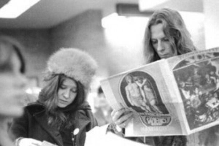 Check this out! Janis and bandmate, James Gurley...looks like they are examining the Oracle?