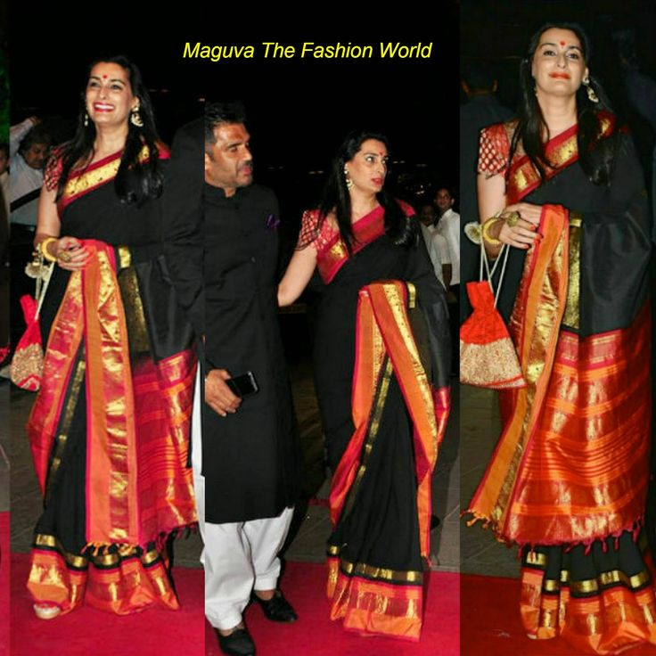 Bollywood actor sunil shetty wife Mana Shetty in black silk saree with contrast orange pallu highlighting the saree with banaras blouse.