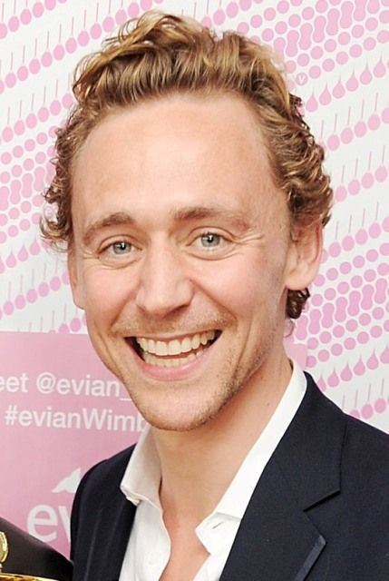 Tom Hiddleston plays table tennis at the evian 'Live young' VIP Suite at Wimbledon with Grace Jones