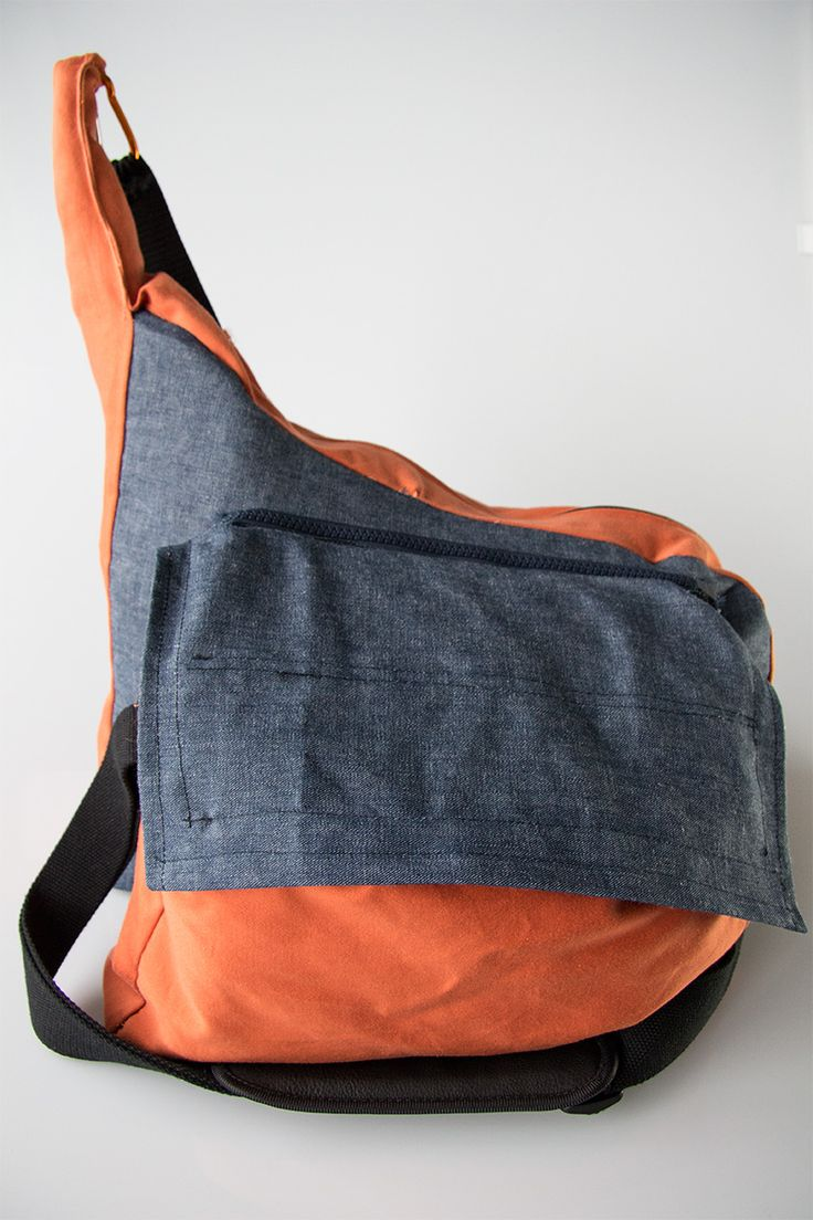 A novel bag design featuring 'zip attachable' accessories and a unique ergonomic shape. Designed for summer, beach, and travel.