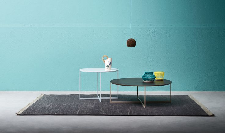 The Moca round occasional table has a painted metal structure and a wooden table top. Moca is available in two sizes.
