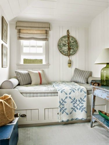 small bedroom idea with built in bed, roman shade, blue and white