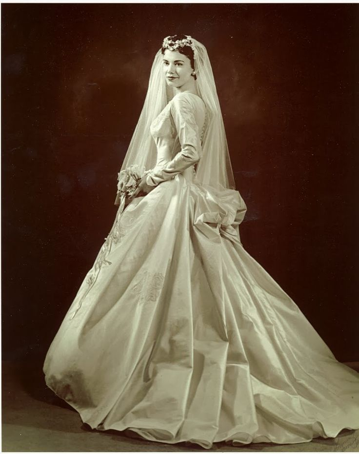 Here is a typical bride's wedding dress from the Fifties.  Bridal portrait, 1957.