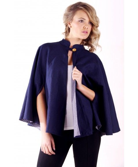 ON A WHIM SPECTACLE CAPE - NAVY    •    Made in Perth,WA  •    100% cotton/linen  •    Fully lined with navy gingham  •    One size fits all   •   Loose fit, mandarine collar and hand slits.  •    Top wooden button at front