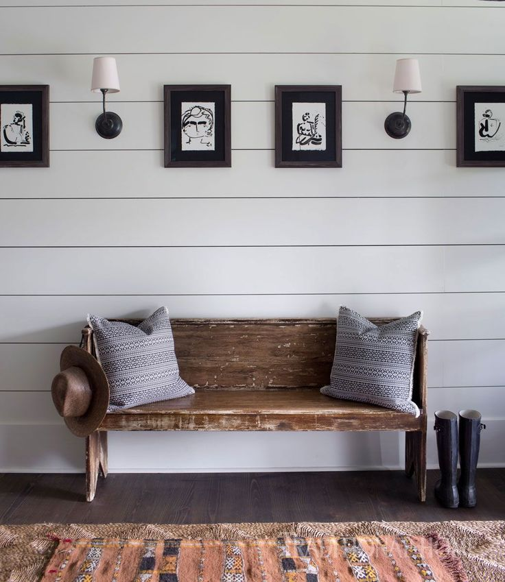 Lighting by Visual Comfort and line drawings by Sally King Benedict add to the entry's simple beauty. - Photo: Sarah Dorio / Design: Cloth & Kind