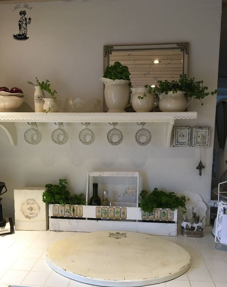 Herbs in an old homemade whte shabby chic container, in my romantic kitchen