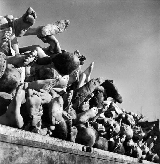 Not published in LIFE. The dead at Buchenwald, piled high outside the camp's incinerator plant, April 1945.- Margaret Bourke-White