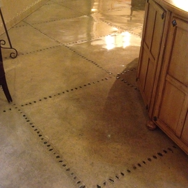 """Polished cement floor with river stones as """"stitching"""".  Paradise Valley Country Club."""