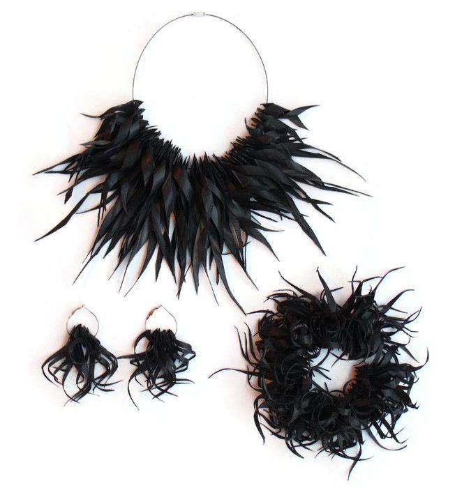 Spiky inner tube necklace, earrings and bracelet set by Laura Zabo