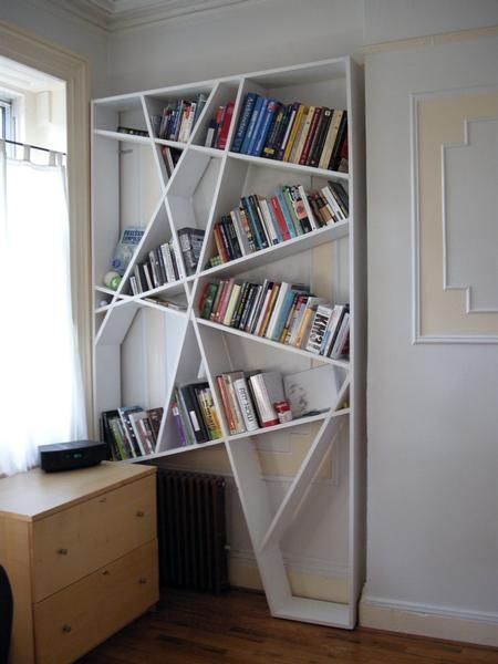This creative, modern bookshelf is a perfect fit for the space and would work well in a bedroom or office.