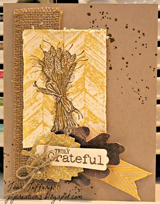 handmade Thanksgive card from J J Creations: Truly Grateful ... kraft base ... brown grunge splatter ... burlap ribbon ... sheaft of wheat image  ... montage of die cut leaves, button with twing bow and fishtail cut ribbon piece ... luv this card!! ... Stampin' Up!