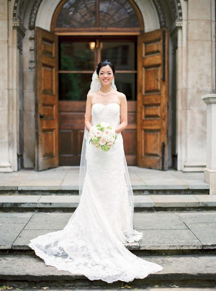 nicholau-nicholas-lau-interracial-wedding-korean-bride-in-front-of-church-doors-bouquet-veil-mermaid-gown-dress