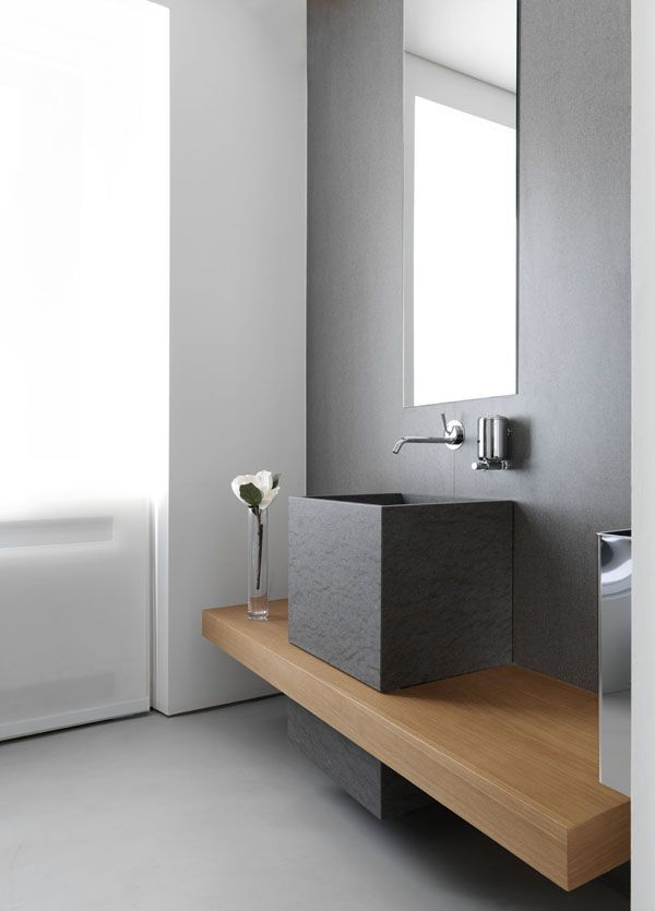 What a gorgeous vanity, but this would definitely need to be a powder room with such a low counter and no storage.