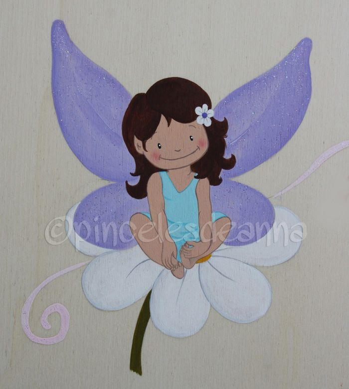 Fairy on a Flower Wearing a Blue Dress