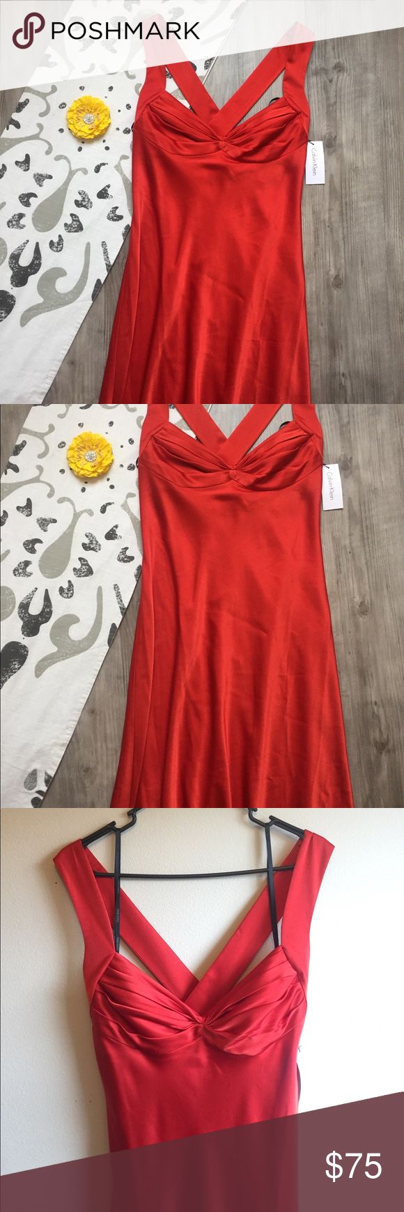 "Calvin Klein Floor Length Gown Absolutely beautiful NWT Calvin Klein gown! Just in time for prom season, this gorgeous gown features a criss-cross back and a sweetheart style neckline; fully lined.  Brand new with tags, this dress is perfect for standing out from the crowd.  Color is listed as Fire; it's not a pure red or orange but that beautiful deep color at the center of a flame -- stunning.  Strap - floor: 62"" Back - floor: 52"" Bottom (fanned): 46"" Strap width: 1.75"" Shoulder…"