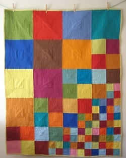 But with shot cotton! knit blanket w/ mitered squares