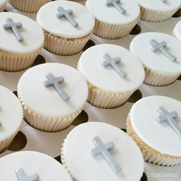 Silver and white crucifix cupcakes