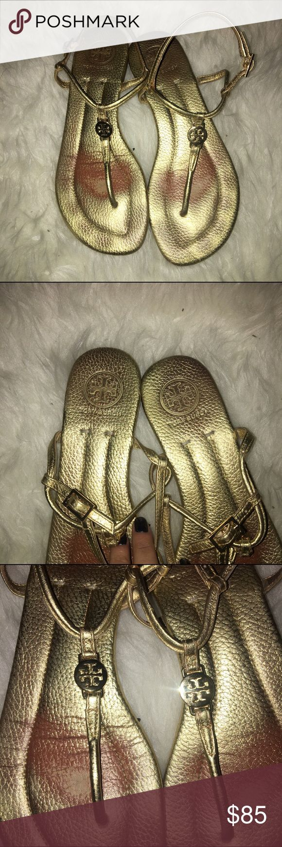 TORY BURCH gold metallic emmy t strap sandal excellent condition; some wear on the insoles, not noticeable when worn. gold metallic leather with sig logo. this style has stopped being made and these are a rare find. soles are near perfect. Tory Burch Shoes Sandals