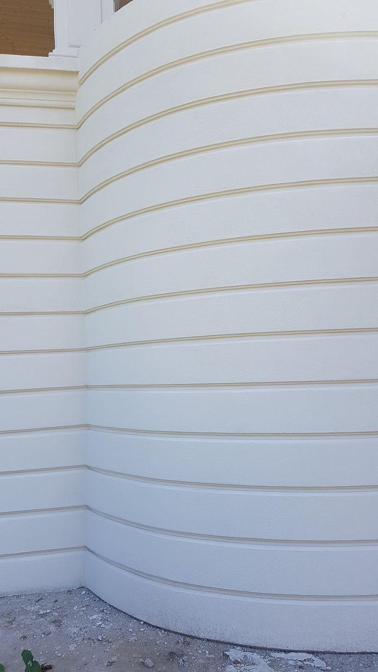 Panouri decorative curbate montate pe fatada casei