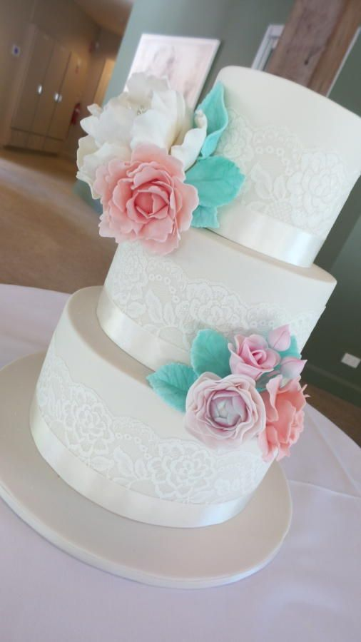 Ivory tiers with pastel blooms... - Cake by Sweet Bea's